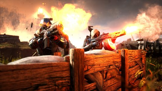 Two soldiers lay down suppressing fire in Outriders